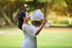 Women Hold bouquet Flower Give flowers Stock Photo