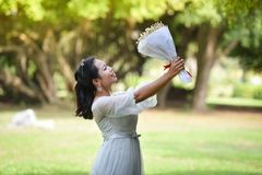 Women Hold bouquet Flower Give flowers. Asian woman Portrait of smiling bride hold bouquet Flower Give flowers Stock Photos