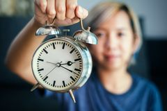 Women hold clock in hand. A Women hold clock in hand stock photography