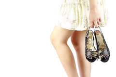 Women hold high heels shoes with fingers. Stock Photography