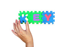 Women hold K alphabet put to its hole for successfully key word Stock Images