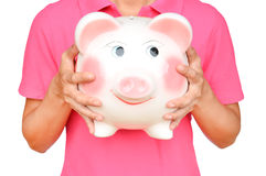 Women hold Pink piggy bank Royalty Free Stock Photos
