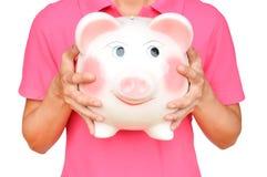 Women hold Pink piggy bank Royalty Free Stock Photos