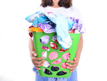 Women hold unwashed cloth in the basket Royalty Free Stock Photography