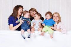 Women holding  babies Stock Image