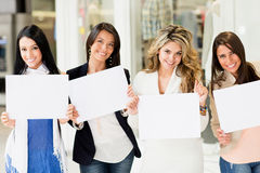 Women holding banners Stock Images