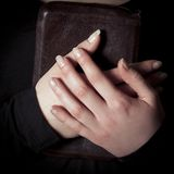 Women Holding a Bible to her Chest Stock Photo