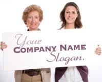 Women holding blank board Stock Photography