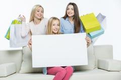 Women holding blank card Stock Image