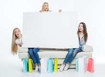Women holding blank card Royalty Free Stock Images