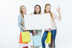 Women holding blank card Royalty Free Stock Image