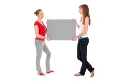Women holding blank poster Stock Photos