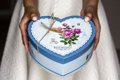 Women holding blue present box. To make a surprise for someone special stock photography