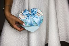Women holding blue present box. To make a surprise for someone special royalty free stock images