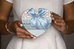 Women holding blue present box. To make a surprise for someone special Stock Images