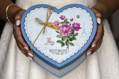 Women holding blue present box. To make a surprise for someone special Royalty Free Stock Photos