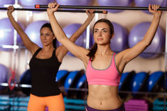 Women holding body bars Royalty Free Stock Image