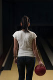 Women Holding A Bowling Ball Royalty Free Stock Image