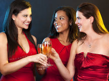 Women holding champagne glasses Stock Photo