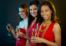 Women holding champagne glasses Royalty Free Stock Photos