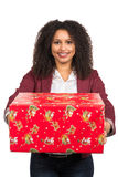 Women is holding a christmas present Stock Photos