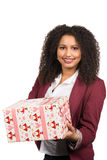 Women is holding a christmas present Stock Photography