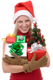 Women holding a christmas tree Royalty Free Stock Images