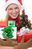 Women holding a christmas tree Stock Photo