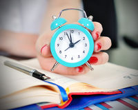 Women holding clock Royalty Free Stock Image