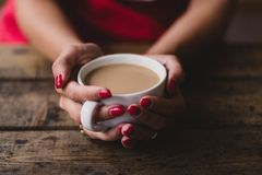 Women Holding Cup Of Coffee Stock Images