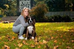 Women Holding Dog Royalty Free Stock Images