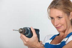 Women holding electric drill Royalty Free Stock Image