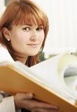 Woman holding a file. Women holding a file. yellow stock photography