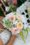 Women holding flowers and bouquet Stock Image