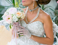 Women holding flowers and bouquet Stock Images