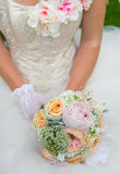 Women holding flowers and bouquet Royalty Free Stock Photography