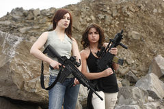 Women holding guns Royalty Free Stock Photos