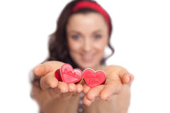 Women holding hearts in her hands. Stock Photography