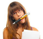 Women holding huge pencil between her teeth Stock Photography