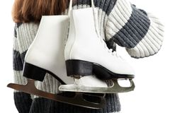 Women holding ice skates Stock Photography