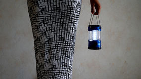 A women holding a lantern. Women holding a lantern in the dark Stock Images