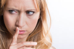 Women holding lips with her finger Stock Images