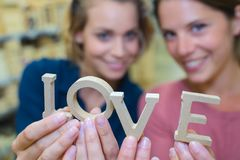 Women holding love letters stock photo