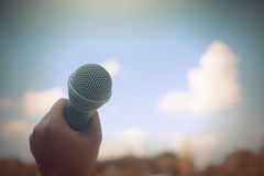 Women holding microphone with instagram like in cross processing. Royalty Free Stock Images