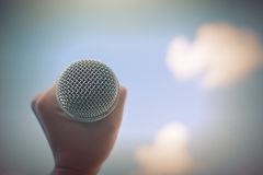 Women holding microphone with instagram like in cross processing. Royalty Free Stock Photos