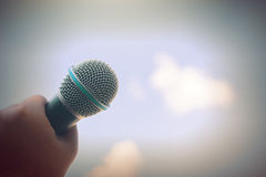 Women holding microphone with instagram like in cross processing. Royalty Free Stock Image