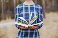 Women holding open book in hands Stock Photos