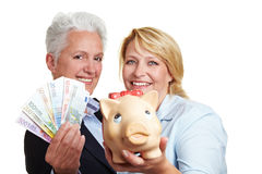 Women holding piggy bank and Euro Royalty Free Stock Photo