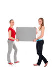 Women holding poster Stock Images