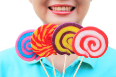 Women holding round swirl lollipop colorful Royalty Free Stock Photos